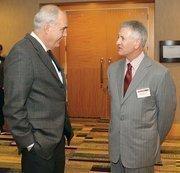 Donald Dempsey, left, of Dempsey Site Management Services LLC chats with Gregg Schwotzer of Crossgates Inc.
