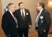 Larry Souleret, left, and Kevin Brett, center, of Lennon, Smith, Souleret Engineering Inc. chats with John Vogel of Tucker Arensberg PC.