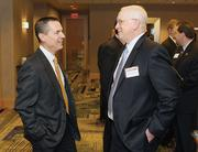 Michael Swisher, left, of Horizon Properties chats with David Rudolph of TriState Capital Bank.