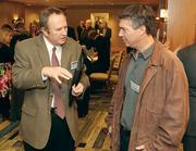 Roger Pearson, left, of IDC Architects / CH2M HILL chats with Chris Caruso of Findlay Municipal Township.