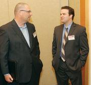 Erich Landis, left, of NorthEast Energy Advisors chats with Patrick Cersosimo of Newmark Grubb Knight Frank.