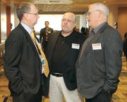 Brad Penrod, left, of the Allegheny County Airport Authority chats with Lee Manges, center, and John McCoy of the Greater Pennsylvania Regional Council of Carpenters.