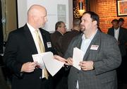 Eric Johnsen, left, of First Commonwealth Bank chats with Christopher Musuneggi of The Musuneggi Financial Group.