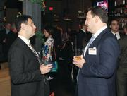 Chris Kail, left, of Legend Financial Advisors, Inc. chats with Philip Goldblum of Goldblum Sablowsky LLC.