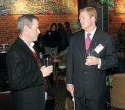 Tim Beamer, left, an independent IT consultant, chats with Bill Engel of Bill Few Associates.