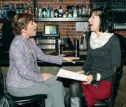 Marcia Kern, left, of Fifth Third Bank chats with Lisa Dillon of Fidelity Bank.