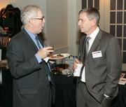 Cole Stearns, left, of INS Management chats with Marshal Linder of ZOLL.