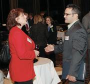 Gwen Mamula of Carnival Cruise Lines chats with Bill Guadalupe of Comcast Business Services.