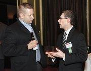 Greg Koledin, left, of Wesex Corp. chats with Robbie Zaremberg of Junior Achievement of Western Pennsylvania.