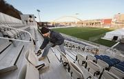Ryan Rupert affixes end caps to seat rails December 12, 2012, in the grandstand of Highmark Stadium, future home of the Pittsburgh Riverhounds and the Pittsburgh Passion.