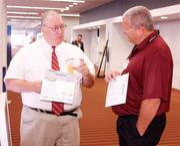 Jeff Scott of Data Science Automation, left, and John Polites of Schaedler Yesco Dist. Inc.