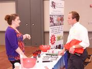 Laura Saunders of Professional Graphic Communications Inc. and Bart Wylie of Tradesmen International.