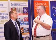 Richard Brueggman, left, of Data Science Automation speaks with Jeff Scott of Data Science Automation.