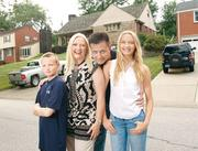 Leagha and Michael Courtney, with their son, Christian, 10, and daughter, Calista, 13, outside of their Mt. Lebanon home. The Courtneys also have an 18-year-old son, Cameron. The Texas couple, who moved to the South Hills in 2007, were part of the first wave of transplants to move into the area as a result of the shale boom.