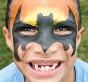 "Rico Crawford, 6, of Sheridan, shows of the face painting he received July 2, 2012 in the Colcom ""Cool Off"" Kids Zone area during the EQT Three Rivers Regatta."