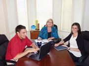 Stoltenberg Consulting Inc. CEO Sheri Stoltenberg and hiring coordinator Neil Pascarella train junior consultant Laura Matusow at the Stoltenberg office in Bethel Park. Matusow's training prepared her for consulting at the University of Pittsburgh Medical Center in surgery specialty clinics.