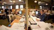 Dina Snider and Mason Radkoff collaborate on construction schedules and budgets at Strada LLC.