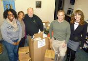 Allegheny Imaging of McCandless LLC donated four carloads of items in November 2011 to Operation Safety Net. Standing with two OSN employees, left, are Dave Nixon, Dr. Jim Withers and Michelle Makepeace.