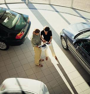 Some real estate developers see auto dealerships as a way to encourage activity on stalled projects.