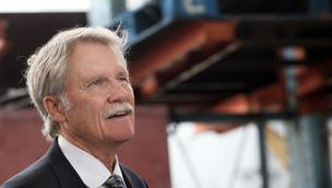 Gov. John Kitzhaber signed the Oregon Investment Act into law a a ceremony in Hillsboro.