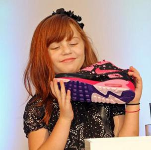 Autumn Boynton, 10, inspects the Nike Air Max 90 she designed as part of Doernbecher Freestyle program.