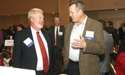 Wally Van Valkenburg, left, managing partner of the Portland office of law firm Stoel Rives LLP, talks business with another award winner.