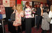 Guests visit exhibitor booths during the annual event.