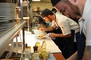 Chefs at RingSide Fish House prepare meals for colleagues during a practice run prior to Monday's formal opening.