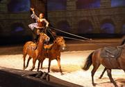 Cavalia's performers take trick riding to new levels. Here, Fairland Fergusson stands atop two horses in the show's Roman riding set.