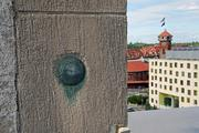 A survey marker is embedded in the roof of the historic U.S. Post Office, future home of PNCA. The Broadway Bridge can be seen in the background.