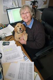 Beth Barker is the chief financial officer at Portland mental health agency Cascadia Behavioral Healthcare Inc. Barker, pictured with her golden lab puppy Bix, gets much of the credit for restoring the agency to financial stability.