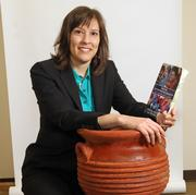 """Cindy Cooper, co-founder and director, Portland State University Impact Entrepreneurs.To Cooper, this massive clay pot honors two names. Her husband, naturally, is named Clay. Her daughter's name """"is Sienna, like the clay found in Siena, Italy."""""""
