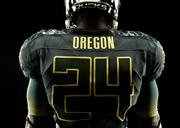 """The Ducks' Rose Bowl jerseys incorporate a redesigned number system featuring an """"iridescent sheen"""" meant to emulate mallard feathers that change colors as they move."""