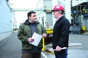 Esco Operations Manager Joel Kershaw chats with continuous improvement coach Michael Funke.Esco Corp. won an Excellence in Training award at the 2012 Oregon Manufacturing Awards.