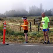 Michelle Lichtenfels waits for a teammate at an early morning exchange point in the Coast Range.