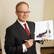 Erick Haynie, partner and commercial trial lawyer with Perkins Coie LLP. Haynie seldom signs a significant piece of paper without his lucky pen.