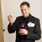 Eric Hulbert, CEO and co-founder of Opus Interactive.Dr. Pepper, poker and traveling - as depicted by his Mexican and Canadian currency - drives Hulbert.