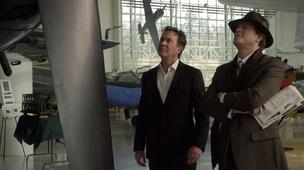 "Actors Timothy Hutton and Cary Elwes stand inside the Evergreen Aviation & Space Museum in a scene from season five debut of ""Leverage."" The storyline of the TNT drama shifted from Boston to Portland for the fifth season, and plot of the first episode includes a theft of Evergreen's Spruce Goose airplane."