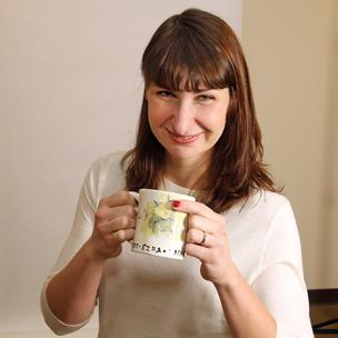 "Jenn Lynch gets a kick out of her ""smudgy"" coffee mug."