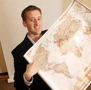 Cameron Madill, CEO, PixelSpoke.Madill wants to visit as many countries as possible. He's already trekked to each dotted area on his map.