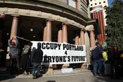 Occupy Portland demonstrators put up a sign outside Portland City Hall Thursday.