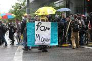 The back of mayoral candidate Cameron Whitten's sandwich-board campaign sign at the Occupy May Day march in downtown Portland.