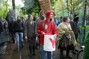 Occupy May Day protesters move through Lownsdale and Chapman parks – the sites of last fall's Occupy encampment.