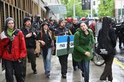 Occupy May Day protesters begin to scatter as they are moved out of the street.