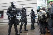 Riot police form a wall during the Occupy May Day protests.