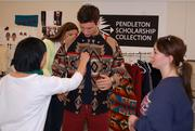 A Cornell student is fitted for a Pendleton-inspired design.