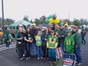 Business Journal Editor Rob Smith (center, back) tailgating here at Autzen Stadium with other UO fans.