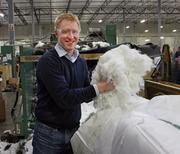 Pacific Furniture Industries' co-owner Nathan Hogglund does his part at the company's manufacturing plant in Tualatin.