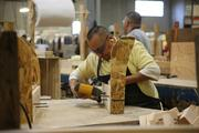 Pacific Furniture Industries' Eleasar Nicolas works at the company's Tualatin manufacturing plant.