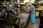 Pacific Furniture Industries' Donna Avgi works at the company's Tualatin manufacturing plant.